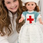18'' Crochet Nursing Doll Uniform. Long Dress With Long Apron And Hat. Pictured With Smiling Little Girl || thecrochetspace.com