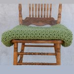 All-Day Everyday Crochet Throw. Folded and placed on a chair || thecrochetspace.com