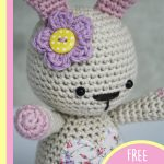 Amigurumi Loved Happy Bunny. Close up of bunney head and accent flower || thecrochetspace.com