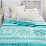 Aqua Crochet Bed Throw. Bed cover shown on bed. Three square motifs. Bed throw in Aqua color || thecrochetspace.com