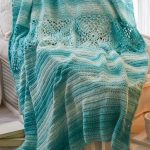 Aqua Crochet Bed Throw. Bed cover thrown on chair. Aqua color, plain with motif panel in middle || thecrochetspace.com