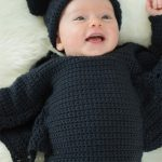 Baby Bat Crochet Set. Image of baby in full set. Black bat romper and matching hat || thecrochetspace.com