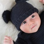Baby Bat Crochet Set. Close up image of Baby wearing matching bat hat in black || thecrochetspace.com