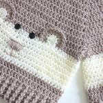 Baby Bear Crochet Sweater. Close up picture of bear face on front of sweater || thecrochetspace.com