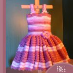 Baby's First Crochet Sundress. Crafted in pink stripes with a pink flower and a full skirt || thecrochetspace.com