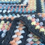 Beanie Crochet Baby Blanket. Multi colored blanket in bean stitch. Close up view || thecrochetspace.com