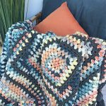 Beanie Crochet Baby Blanket. Multicolored Baby blanket crafted in Bean Stitch. Thrown over chair || thecrochetspace.com