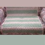 Beginners Cupcake Crochet Afghan. Crafted in pastel pink and green and placed on a sofa || thecrochetspace.com