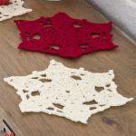 Big Snowflake Crocheted Doilies. One red and one cream large snowflake image    thecrochetspace.com