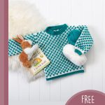 Bobble Crochet Baby Sweater. Crafted in turquoise and white and laid flat on the floor with children's toys || thecrochetspace.com