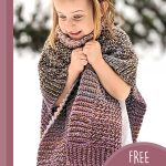 Children's Crochet Penny Poncho. Little girl clutching poncho || thecrochetspace.com