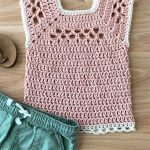Children's Midnight Crochet Top. Childs version of Adult top. Square necked Vest. Pale pink with white edging displayed with green shorts || thecrochetspace.com