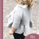 Childs Fluted smock jacket. Crafted in grey. Side view || thecrochetspace.com