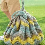 Convertible Drawstring Crochet Bag Tied Up, With Possessions inside. Crocheted In Colors Of Green, yellow And Brown || thecrochetspace.com
