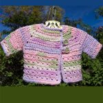 Credence Crochet Baby Cardigan. Asymetrical front with two buttons. Crafted in pastel colors || thecrochetspace.com