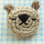 Crochet Bear Face Brooch. Little bear face with embroidered detailing    thecrochetspace.com