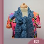 Crochet Bridal Flower Shawl. Crafted here in blue and worn over a flowered blouse    thecrochetspace.com