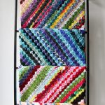 Crochet C2C Yarn Buster. 3x different colored blankets folded over a rungs of a ladder || thecrochetspace.com