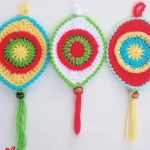 Crochet Christmas Boho Ornament. Three ornaments in different colors || thecrochetspace.com