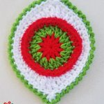 Crochet Christmas Boho Ornament. One ornament crafted in white, red and green || thecrochetspace.com