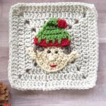 Crochet Christmas Elf Applique. Crafted on a beige, plain Granny Square with a red and green Santa hat on || thecrochetspace.com