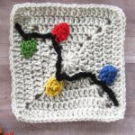 Crochet Christmas Lights Applique. Crafted onto a plain, beige, Granny Square. Black cord and multi-colored lights    thecrochetspace.com
