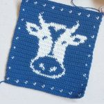Crochet Cow Hot Pad. Crafted in Blue and White with image of Cow's head || thecrochetspace.com