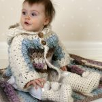 Crochet Cozy Baby Set. Image of baby in jacket and boots, crafted in cream and pastels || thecrochetspace.com