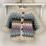 Crochet Cozy Baby Set. Image of hanging jacket with hood || thecrochetspace.com