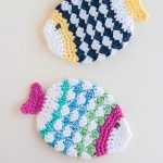 Crochet Fish Scrubbies. 2x fish scrubbies swimming past each other    thecrochetspace.com