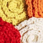 Crochet Flower Face Cleansing Pads. Four scrubber pads filling the image completely || thecrochetspace.com
