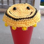 Crochet Glass Cover Duo. 1 of 2 Patterns. Kiddie Pattern Smiley face in bright yellow with smiley beads   thecrochetspace.com