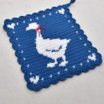 Crochet Goose Hot Pad. White goose on blue background with red ribbon at neck    thecrochetspace.com