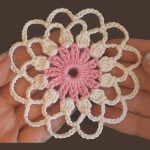 Crochet Lace Flower Motif. One held in a hand || thecrochetspace.com