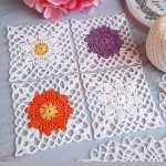 Crochet Lace Flower Square. White squares with vibrant flower middle || thecrochetspace.com