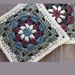 Crochet Lily Pad Granny Square. Beautiful square crafted in burgandy, blue, grey and white. Image on the diagonal    thecrochetspace.com