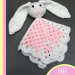 Crochet Mini Bunny Lovey. Blanket folded, bunny head outstretched. Crafted in pink and white    thecrochetspace.com