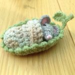 Sleepy Socks Crochet Mouse. Tiny little grey mouse in leaf bed with blanket || thecrochetspace.com