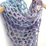Easy Crochet Net Cowl On A Hanger. Front view with One Visible Button || thecrochetspace.com