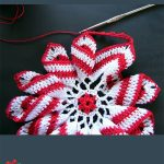 Crochet Peppermint Pinwheel Doily. Doily in progress being crafted || thecrochetspace.com