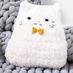 Crochet Plush Pussy Pillow. White fur cat with tiny yellow bow tie    thecrochetspace.com