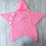 Crochet Star Baby Wrap. Pink, star shaped cozy wrap    thecrochetspace.com