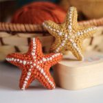 Crochet Summer Softie Starfish. Two Starfish. One crafted in orange and the other in mustard || thecrochetspace.com
