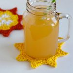 Crochet Summer Sun Coasters. A jar of drink On one yellow coaster    thecrochetspace.com