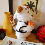 Crochet Super Sushi Cat. Side view with sushi in his hand || thecrochetspace.com
