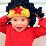 Crochet Wonder Woman Wig. Little girl in full black spiral crochet hair wig with added yellow crown and red star    thecrochetspace.com