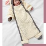 Crochet Baby Sheep Cocoon. Small infant dressed in the sheep snuggle sack    thecrochetspace.com