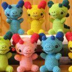 Crocheted Baby Dragon Rattle. Lots of different colored Dragon rattles || thecrochetspace.com