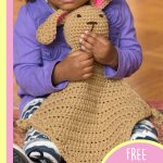 Crocheted Bunny Comfort Blankie. Child clutching brown bunny blankie || thecrochetspace.com