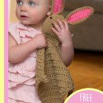 Crocheted Bunny Comfort Blankie. Child carrying bunny blanket with pink ears || thecrochetspace.com
